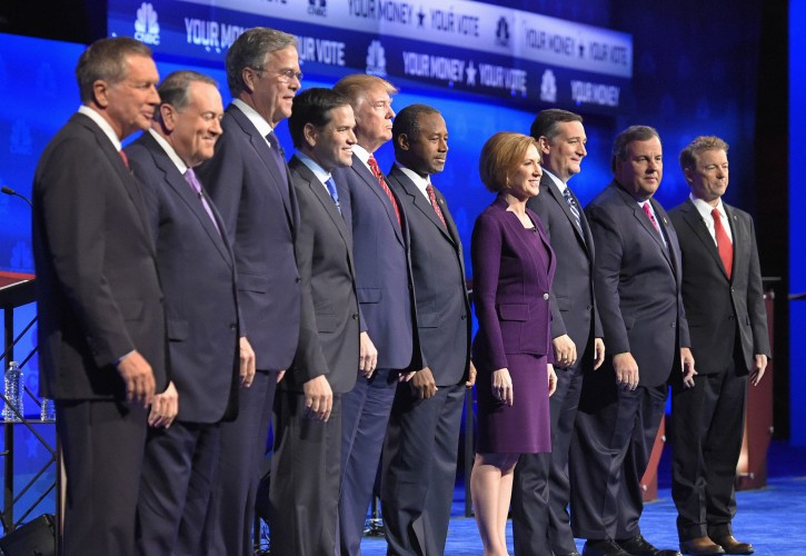 In this photo taken Oct. 28, 2015, Republican presidential candidates, from left, John Kasich, Mike Huckabee, Jeb Bush, Marco Rubio, Donald Trump, Ben Carson, Carly Fiorina, Ted Cruz, Chris Christie, and Rand Paul take the stage during the CNBC Republican presidential debate at the University of Colorado, in Boulder, Colo. Christie could be relegated off the main stage at next week's GOP presidential debate and Bobby Jindal and George Pataki risk being shut out altogether, as the trio become potential victims of their poor showings in preference polling and how those polls are being used. (AP Photo/Mark J. Terrill)