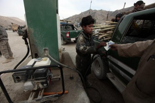FILE - An Afghan employee fills a car with petrol at a gas station in the town of Saway-kowt in Khowst province, Afghanistan, December 26, 2009.  REUTERS/Zohra