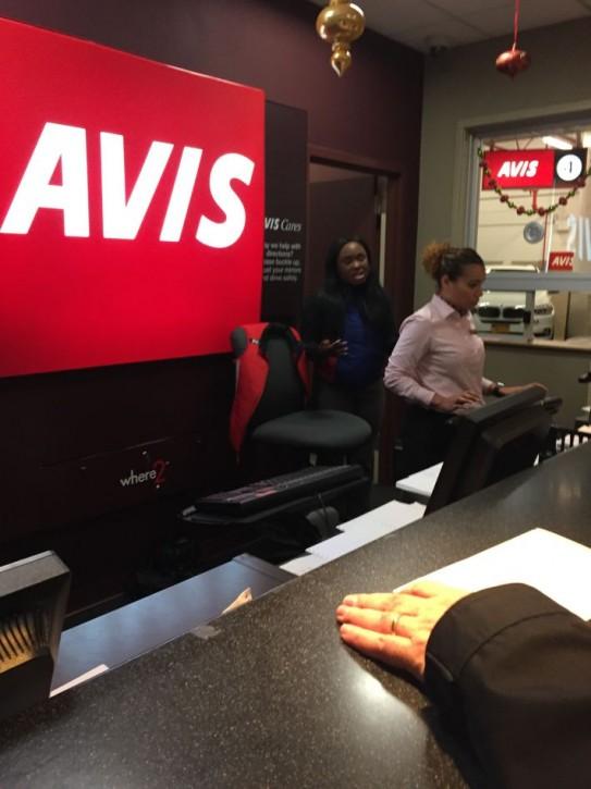 Avis reservation agent Angelline (white shirt) and her manager Shamoura.