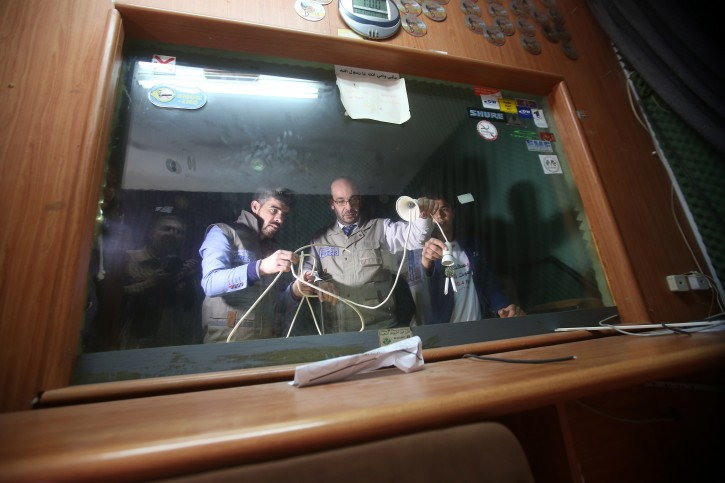 Palestinian journalists inspect the damage of the Al-Khalil radio station in the West Bank city of Hebron, 21 November 2015. EPA