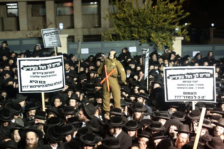 Ultra orthodox Jewish men protest against the army draft, in Jerusalem's Mea Shearim neighbourhood on December 22, 2015. Photo by Yonatan Sindel/Flash90