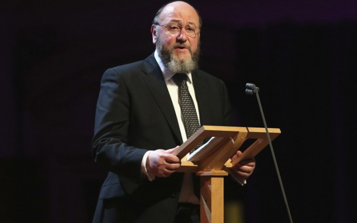 FILE - Chief Rabbi Ephraim Mirvis gives a speech as he attends a Holocaust Memorial Day Ceremony at Central Hall Westminster Holocaust Memorial Day service at Methodist Central Hall in Westminster, London, Britain - 27 Jan 2015 (Rex Features via AP Images)