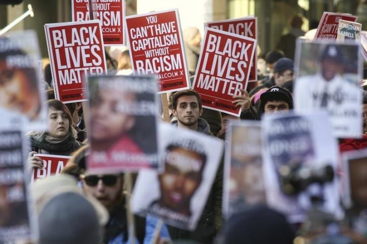 FILE - Black Lives Matter protesters gather in Westlake Park near Westlake Mall during Black Friday in Seattle, Washington November 27, 2015. REUTERS/David Ryder
