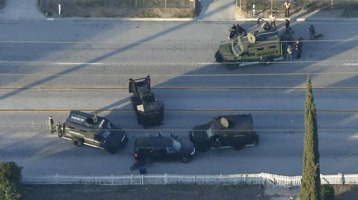 An SUV with its windows shot out that police suspect was the getaway vehicle from at the scene of a shooting in San Bernardino, California is shown in this aerial photo December 2, 2015.  Gunmen opened fire on a holiday party on Wednesday at a social services agency in San Bernardino, California, killing 14 people and wounding 17 others, then fled the scene, triggering an intense manhunt and a shootoutout with police, authorities said. REUTERS/Mario Anzuoni