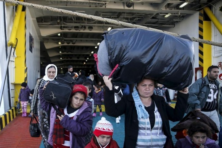 FILE - Refugees and migrants arrive aboard the passenger ferry Eleftherios Venizelos from the island of Lesbos at the port of Piraeus, near Athens, Greece, December 18, 2015.  REUTERS/Alkis Konstantinidis