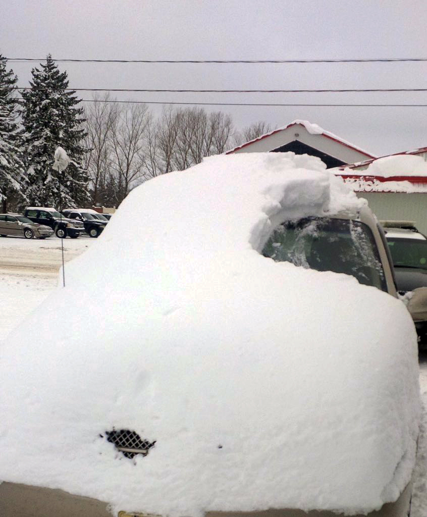 Car Covered In Snow : Ontario canada man charged after his car almost