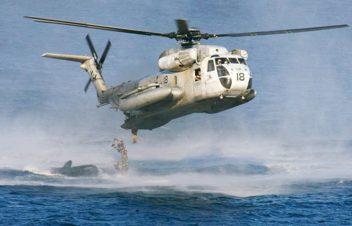 FILE - In this Feb. 18, 2003 file photo, U.S. Marines and their Philippine counterparts jump from a US Marines CH-53D Sea Stallion helicopter at Ternate in Cavite province south of Manila. The U.S. Coast Guard says two similar Marine helicopters have collided off the Hawaiian island of Oahu, Friday, Jan. 15, 2016.   (AP Photo/Bullit Marquez, File)