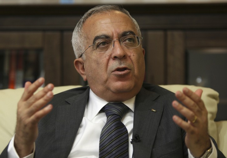 FILE - In this June 28, 2011 file photo, Salam Fayyad, economist and former Palestinian prime minister, speaks during an interview with The Associated Press in the West Bank city of Ramallah.  (AP Photo/Majdi Mohammed, File)