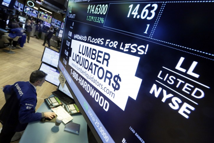 Specialist Anthony Rinaldi works on the trading floor of the New York Stock Exchange, adjacent to the post that handles Lumber Liquidators, Monday, Feb. 1, 2016. (AP Photo/Richard Drew)