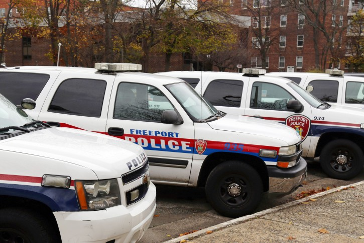 In this Nov. 19, 2015, photo, police department vehicles are lined up outside of Village Hall in Freeport, N.Y. Each computer-equipped vehicle receives data from license plate scanners positioned around the village. The data influx has increased the department's workload and has caught the attention of civil libertarians. (AP Photo/Michael Balsamo)