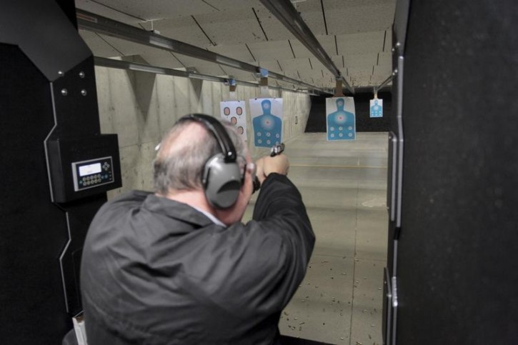 FILE - U.S. Republican presidential candidate Mike Huckabee takes target practice at Crossroads Shooting Shooting Sports in Johnston, Iowa, January 30, 2016. REUTERS/Brian C. Frank