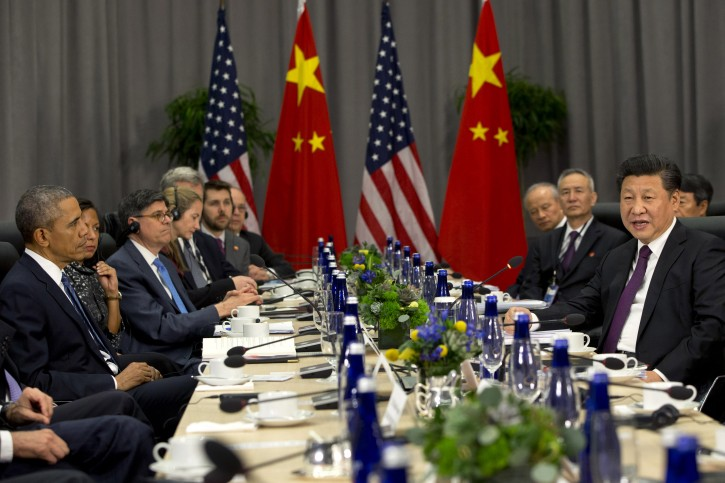 President Barack Obama listens at left as Chinese President Xi Jinping speaks during their meeting at the Nuclear Security Summit in Washington, Thursday, March 31, 2016. (AP Photo/Jacquelyn Martin)