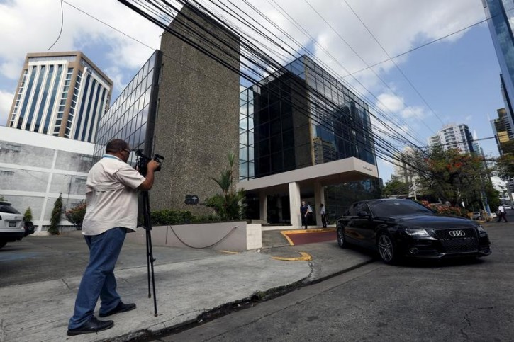 A cameraman is seen outside the Arango Orillac Building where the Mossack Fonseca law firm is situated at, in Panama City, April 4, 2016. REUTERS/Carlos
