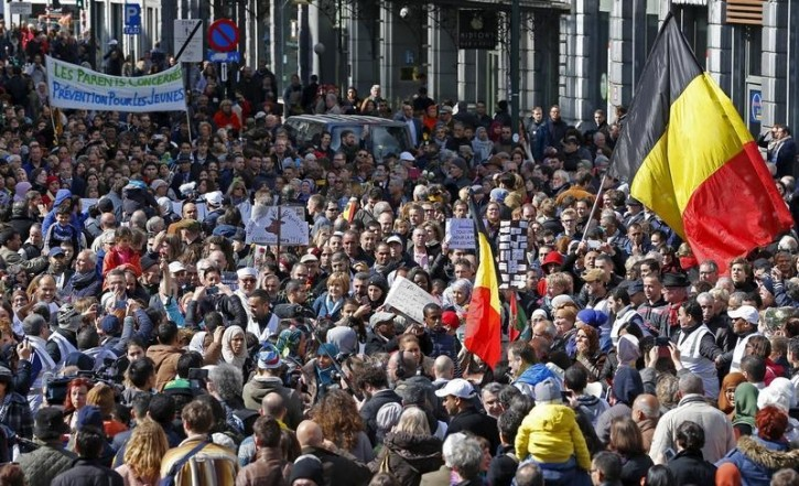 """People take part in a rally called """"The march against the fear, Tous Ensemble, Samen Een, All Together"""" in memory of the victims of bomb attacks in Brussels metro and Brussels international airport of Zaventem in Brussels, Belgium, April 17, 2016. REUTERS/Yves Herman"""