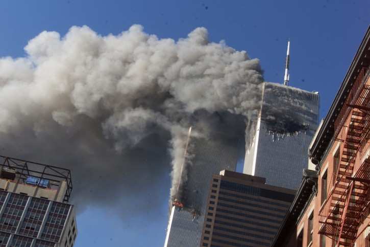 FILE - In this Sept. 11, 2001 file photo, smoke rising from the burning twin towers of the World Trade Center after hijacked planes crashed into the towers, in New York City. Every American of a certain age has a 9/11 story _ vivid memories of where they were, what they saw, how they felt on that awful day. (AP Photo/Richard Drew, File)
