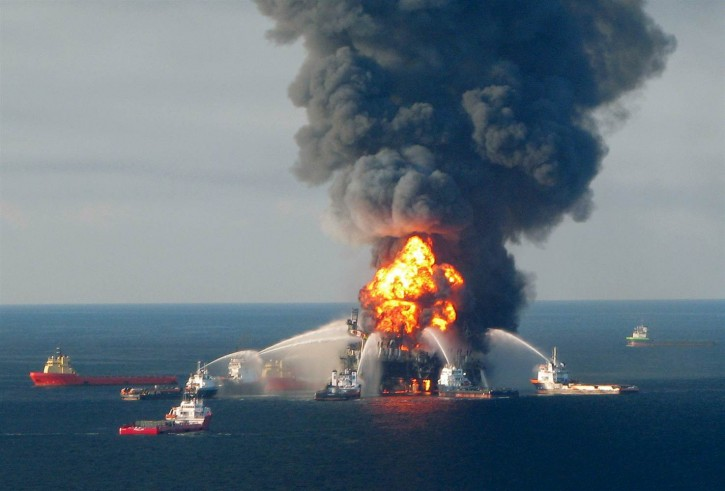 Fire boats battle the blazing remnants of the off shore oil rig Deepwater Horizon, off Louisiana, in this April 21, 2010 handout file photo. U.S. Coast Guard via Reuters