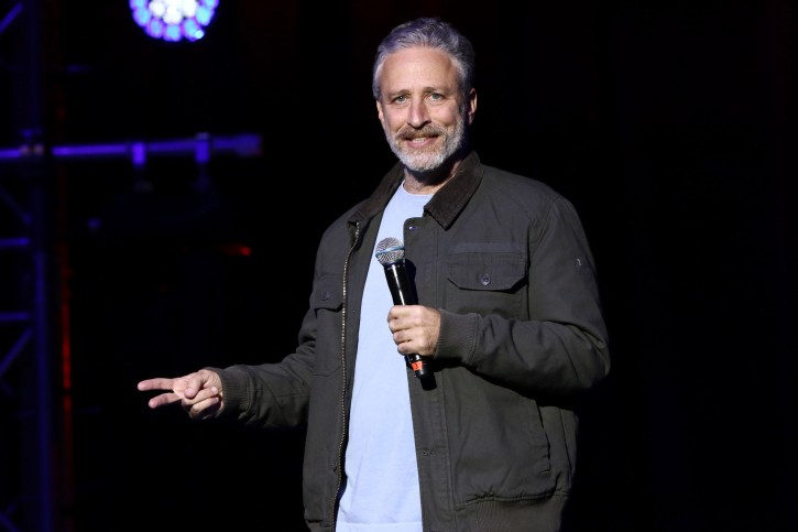 """FILE - In this Tuesday, Nov. 10, 2015, file photo, comedian Jon Stewart performs at the 9th Annual Stand Up For Heroes event, in New York. During a taping of a podcast with President Barack Obama's former aide on Monday, May 9, 2016, Stewart described presumptive Republican presidential nominee Donald Trump as a """"man-baby.""""(Photo by Greg Allen/Invision/AP, File)"""