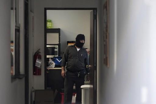 FILE  -Police investigators stand inside the Mossack Fonseca offices in San Salvador, El Salvador April 8, 2016.