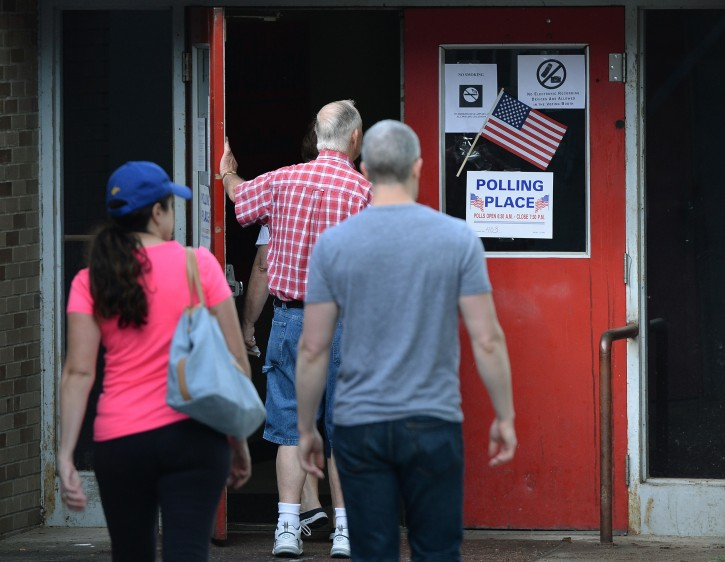Voters enter their polling place at Stonewall Jackson Middle School in the West Side neighborhood of Charleston, W.Va., Tuesday, May 10, 2016. (Chris Dorst/Gazette-Mail via AP)