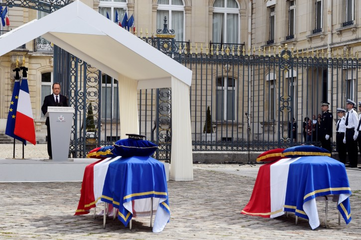 French President Francois Hollande delivers a speech during a memorial ceremony honoring the two police officials killed by an  extremist claiming allegiance to IS,  Friday, June 17, 2016 in Versailles, near Paris.  Police commander Jean-Baptiste Salvaing and his companion, police administrator Jessica Schneider were stabbed Monday by attacker Larossi Abballa, who was killed in a police raid. (Dominique Faget, Pool via AP)