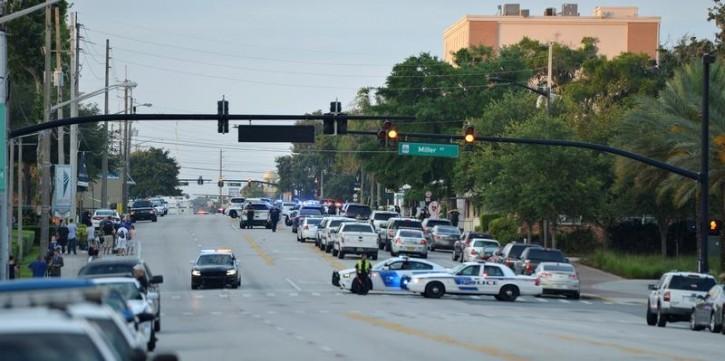 Police lock down Orange Avenue around Pulse nightclub, where people were killed by a gunman in a shooting rampage in Orlando, Florida June 12, 2016.  REUTERS/Kevin Kolczynski