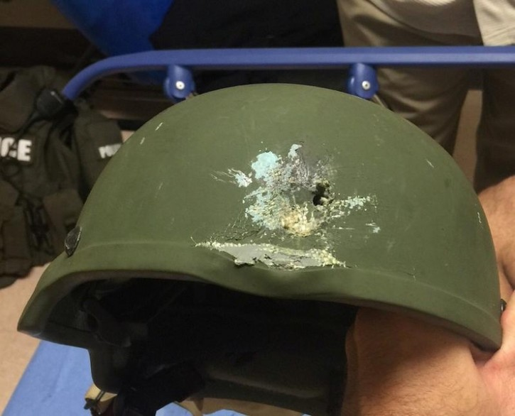 """A handout photograph posted by the Orlando Police Department on Twitter with the words, """"Pulse shooting: In hail of gunfire in which suspect was killed, OPD officer was hit. Kevlar helmet saved his life"""", in reference to the operation against a gun man inside Pulse night club in Orlando, Florida, June 12, 2016. Orlando Police Department/Handout via REUTERS"""