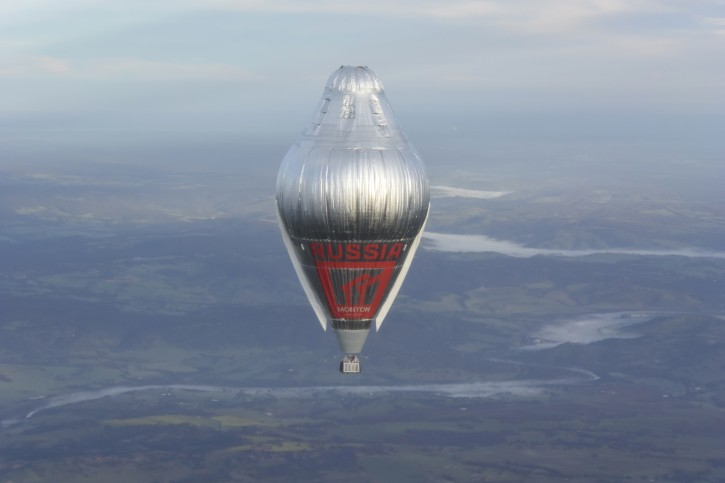 In this July 12, 2016 Hand Out photo supplied by MORTON, Russian adventurer Fedor Konyukhov floats  at more than 6,000meters (20,000  feet) above Northern Western Australia, in his helium and hot-air balloon as he makes a record attempt to fly solo in a balloon around the world nonstop.  65-year-old Konyukhov was battling sleep deprivation, freezing temperatures and ice in his oxygen mask as he nears the end of his record attempt to fly solo around the world nonstop, his son said on Wednesday July 20, 2016.(Photo/Oscar Konyukhov/Morton Via AP)