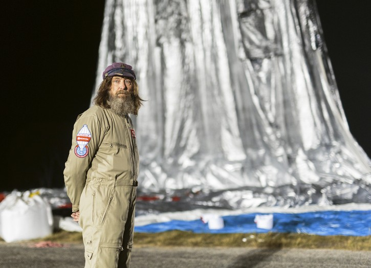 In this July 11, 2016 Hand Out photo supplied by MORTON, Russian adventurer Fedor Konyukhov waits as his helium and hot-air balloon inflates before lift off on his  record attempt to fly solo in a balloon around the world nonstop. (Photo/Oscar Konyukhov/Morton Via AP)