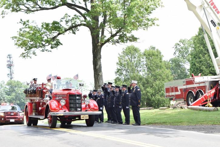 Firefighters saluting Hillcrest Fire Department Lay Chaplain Richard Mordechai Silverberg outside the Brick Church Cemetery in Spring Valley (Sandy Eller/VINnews.com)