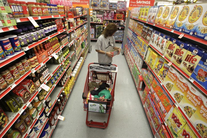 FILE - In this Dec. 14, 2010, file photo, Alicia Ortiz shops through the cereal aisle as her daughter Aaliyah Garcia catches a short nap in the shopping cart at a Family Dollar store in Waco, Texas. (AP Photo/Tony Gutierrez, File)