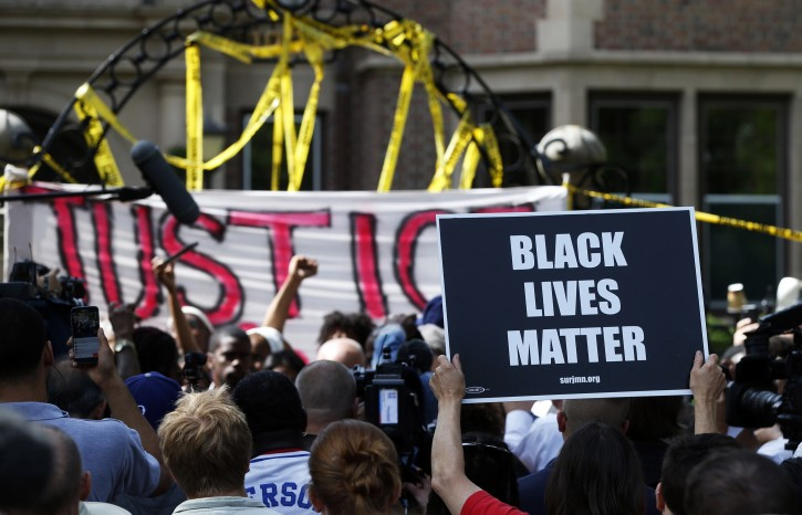 Protesters gather outside the governor's residence Thursday, July 7, 2016, in St. Paul, Minn. to condemn the shooting death by police of Philando Castile Wednesday night in Falcon Heights, Minn. after a traffic stop by St. Anthony police.  AP Photo/Jim Mone)