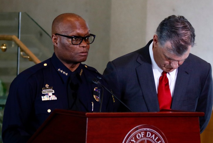 Dallas Mayor Mike Rawlings, right, and Dallas Police Chief David Brown answer questions from the media during a news conference in Dallas, Friday, July 8, 2016.  Snipers opened fire on police officers in the heart of Dallas during protests over two recent fatal police shootings of black men.   (David Woo/The Dallas Morning News via AP)