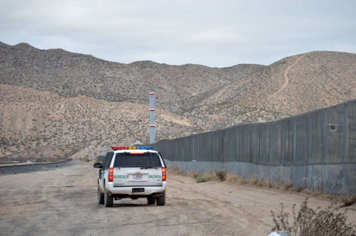 FILE - In this Jan. 4, 2016 file photo, a U.S. Border Patrol agent patrols Sunland Park along the U.S.-Mexico border next to Ciudad Juarez. A new Cronkite News-Univision News-Dallas Morning News Border Poll released Monday, July 18, 2016, says a majority of residents surveyed on both sides of the U.S.-Mexico border are against the building of a wall between the two countries. The poll also suggests residents feel Democrats and Republicans are ignoring their concerns and aren't proposing solutions to help their economy and combat drug trafficking and human smuggling. (AP Photo/Russell Contreras,File)