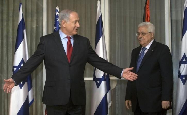 FILE - Israel's Prime Minister Benjamin Netanyahu (L) gestures beside Palestinian President Mahmoud Abbas before their meeting in Jerusalem September 15, 2010. Reuters