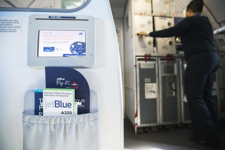 FILE - A pamphlet displaying details of JetBlue's high speed inflight Internet service named Fli-Fi sits in a pouch on a special JetBlue media flight out of John F. Kennedy International Airport in New York December 11, 2013.  Reuters