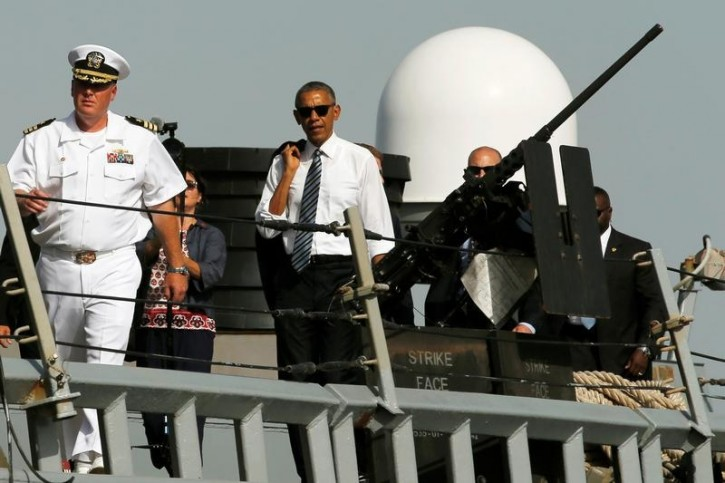 U.S. Navy Commander Russell Caldwell (L) gives U.S. President Barack Obama a tour of the U.S. Navy destroyer USS Ross at Naval Station Rota in Rota, Spain, July 10, 2016. REUTERS/Jonathan Ernst