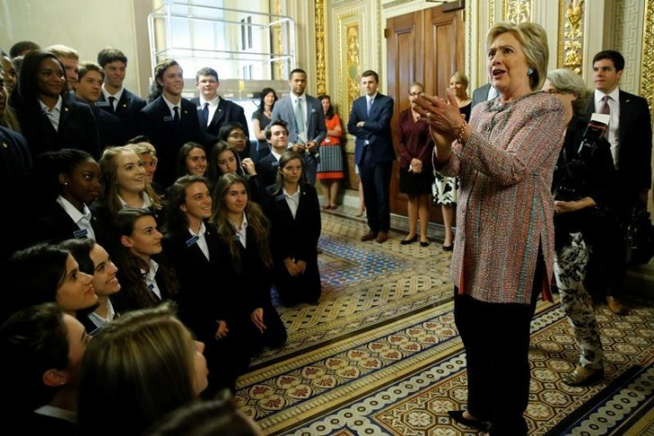 Democratic U.S. presidential candidate Hillary Clinton speaks with Senate pages as she departs after meeting with Senate Democrats during their luncheon gathering at the U.S. Capitol in Washington, U.S. July 14, 2016.  REUTERS/Jonathan Ernst