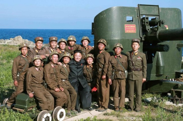 North Korean leader Kim Jong Un poses with soldiers during an inspection of the defence detachment on Ung Islet, which is defending an outpost in the East Sea of Korea, in this undated photo released by North Korea's Korean Central News Agency (KCNA) in Pyongyang July 7, 2014. REUTERS/KCNA/File Photo