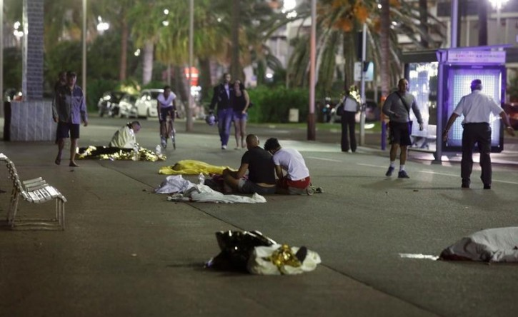 VISUAL COVERAGE OF SCENES OF INJURY OR DEATH - Bodies are seen on the ground July 15, 2016 after at least 30 people were killed in Nice, France, when a truck ran into a crowd celebrating the Bastille Day national holiday July 14.   REUTERS/Eric Gaillard