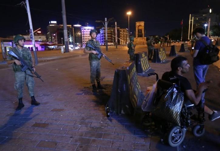 Turkish military stand guard near the the Taksim Square in Istanbul, Turkey, July 15, 2016.   REUTERS/Murad Sezer
