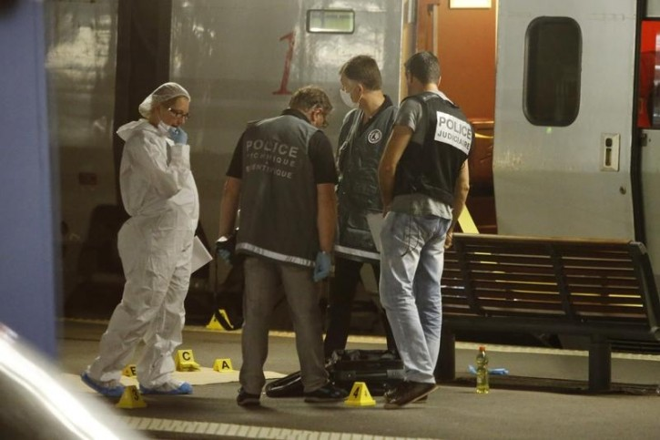 FILE v- French investigating police check for clues on the train platform in Arras, France, August 21, 2015. AP