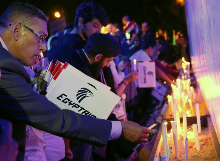 FILE - People light candles during a candlelight vigil for the victims of EgyptAir flight 804, at the Cairo Opera House in Cairo, Egypt May 26, 2016. REUTERS/Mohamed Abd El