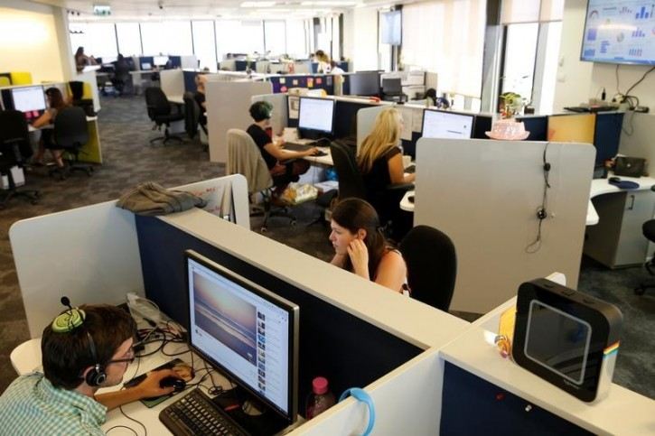 FILE - Employees work at Internet data firm SimilarWeb at their offices in Tel Aviv, Israel July 4, 2016. REUTERS/Baz Ratner