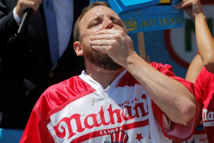 Winning entrant Joey Chestnut competes in the Fourth of July International Hot Dog-Eating Contest at Coney Island in Brooklyn, New York, U.S., July 4, 2016.  REUTERS/Andrew Kelly