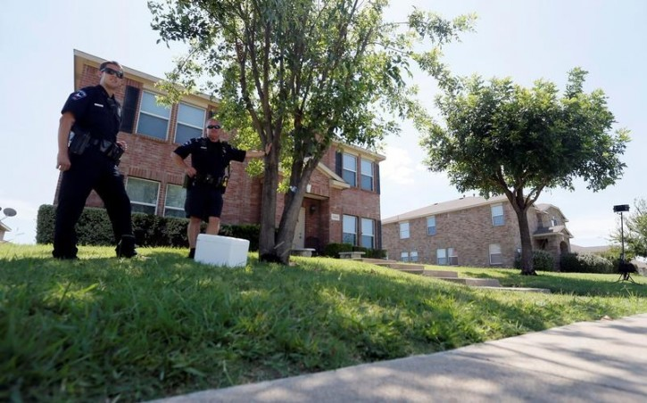 Mesquite police officers stand guard outside the house of Dallas shooting suspect Micah Xavier Johnson in Dallas, Texas, U.S. July 8, 2016. REUTERS/Brandon Wade
