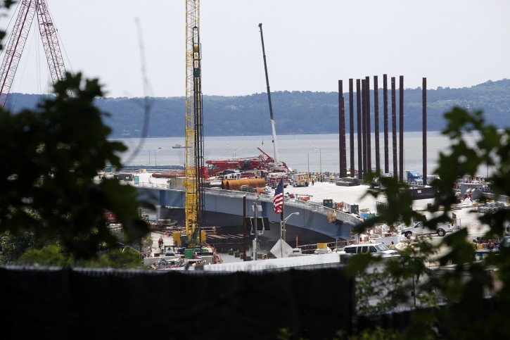 A construction crane sprawls across lanes in both directions after collapsing on the Tappan Zee Bridge, Tuesday July 19, 2016, in New York.  (AP Photo/The Journal News, Ricky Flores)