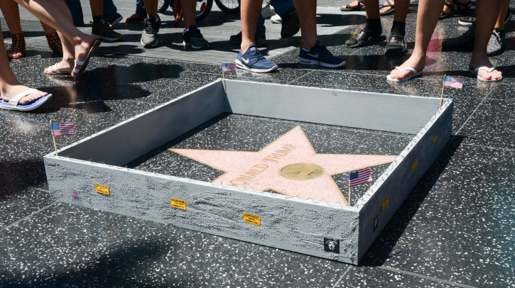 A handout image provided by the artist called Plastic Jesus on 20 July 2016 shows sightseeers looking at Donald Trump's Star on the Hollywood Walk of Fame, in Hollywood, California, USA, 19 July 2016. EPA