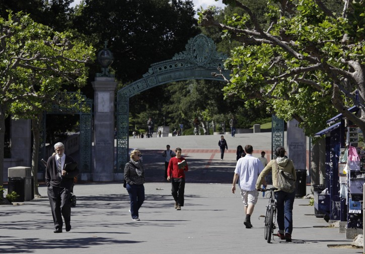 FILE - In this June 1, 2011, file photo, people walk through Sproul Plaza near the Sather Gate on the University of California, Berkeley campus in Berkeley, Calif. The university suspended a class on Sept. 13, 2016, amid complaints that it shared anti-Semitic viewpoints and was designed to indoctrinate students against Israel. (AP Photo/Eric Risberg, File)