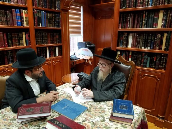 Rabbi Yechiel Steinmetz Dyan of Square analyzing the bulb with Morty Kohn