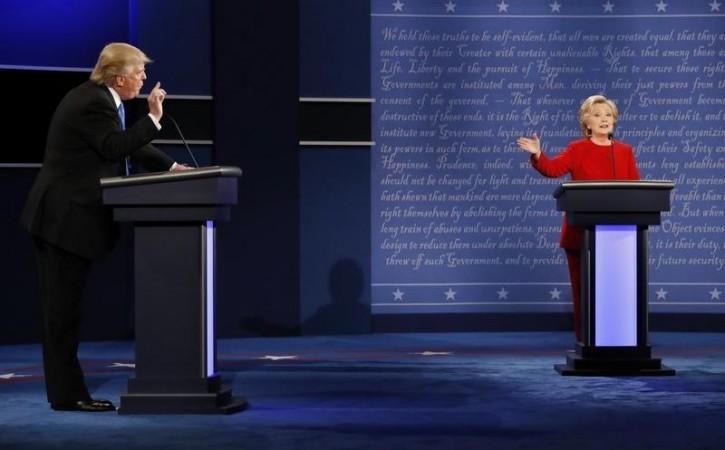 Republican U.S. presidential nominee Donald Trump and Democratic U.S. presidential nominee Hillary Clinton speak during their first presidential debate at Hofstra University in Hempstead, New York, U.S., September 26, 2016.   REUTERS/Brian Snyder   -